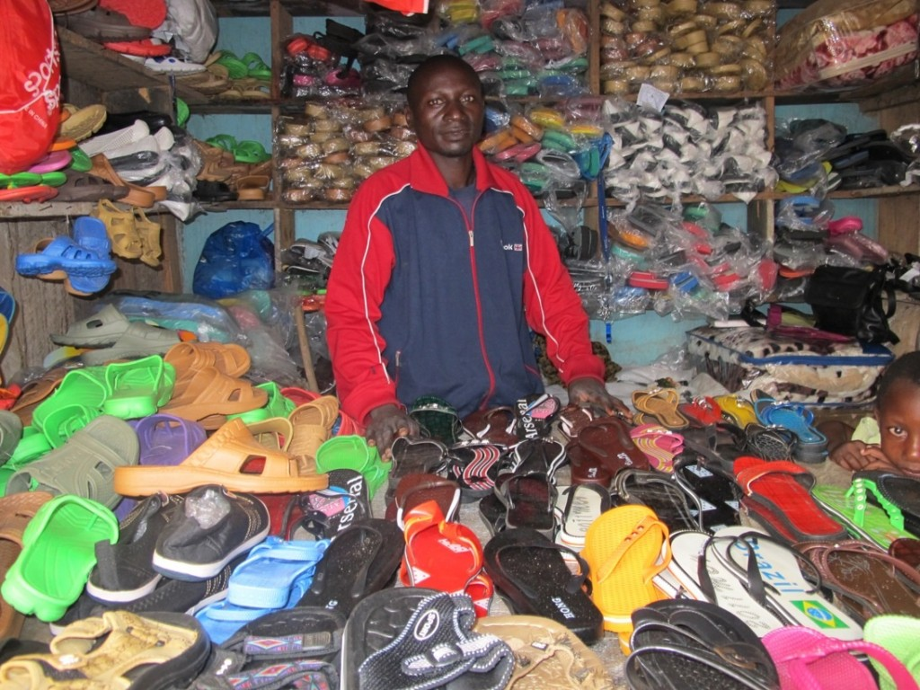 Shoes for sale in Malawi. Photo by Duncan McNicholl at http://untappedmarkets.ca/2011/04/a-day-without-dignity-duncan-mcnicholl/