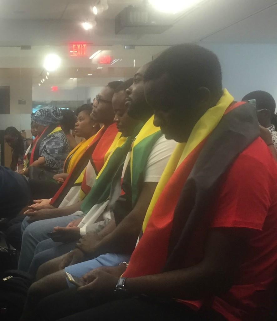 Zimbabweans at the Atlantic Council, draped in the flag.